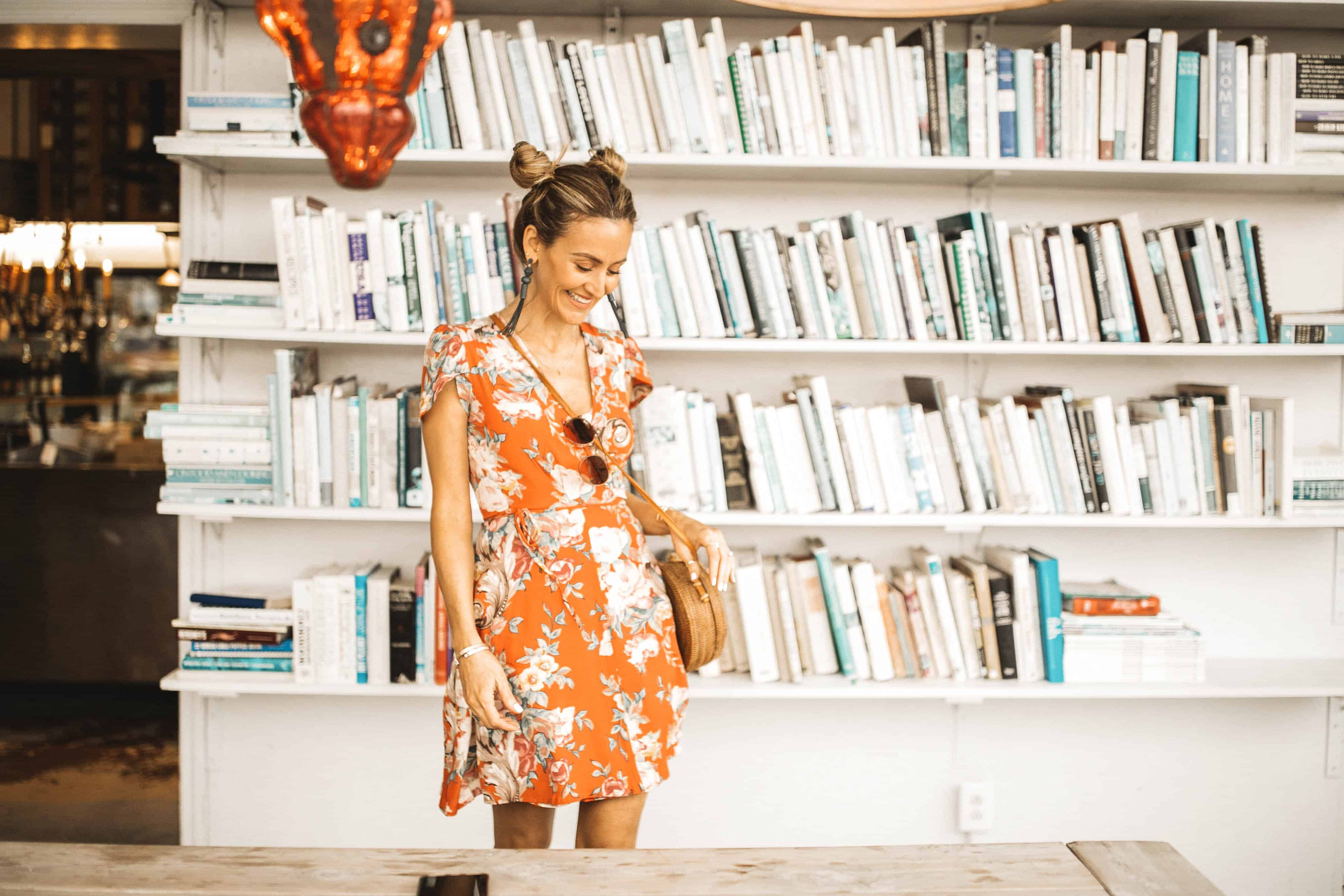 piggy buns hair style and coral floral dress - Spring Essentials: Lulus Dresses, Shorts, Top and Jumpsuit featured by popular Indianapolis fashion blogger, Karina Style Diaries