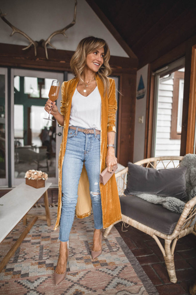 Astr the label long gold velvet duster | Karina Style Diaries | Styling a long velvet duster featured by top US fashion blogger, Karina Style Diaries: image of a woman wearing a gold ASTR long velvet duster, Levi's ripped skinny jeans, Double G Gucci belt, Gucci Petit Marmont and Sam Edelman Toe Pumps