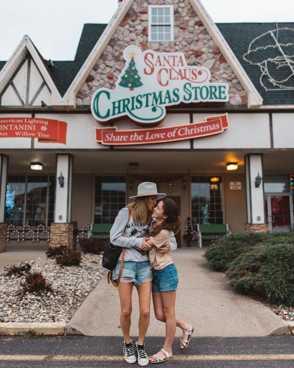 Christmas Store in Santa Claus Indiana, mom and daughter hugging