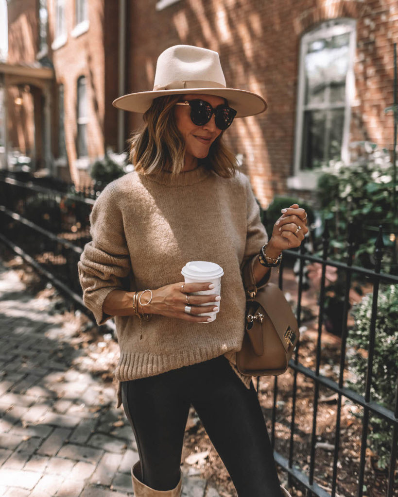 Karina Style Diaries wearing spanx faux leather leggings tan oversized sweater tall suede tan boots lack of color hat