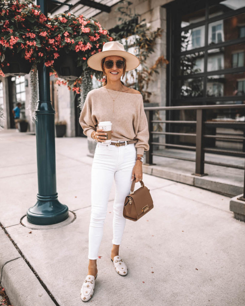 Karina Style Diaries wearing white skinny jeans gucci princetown loafers gucci belt oatmeal off the shoulder sweater Zac Posen handbag