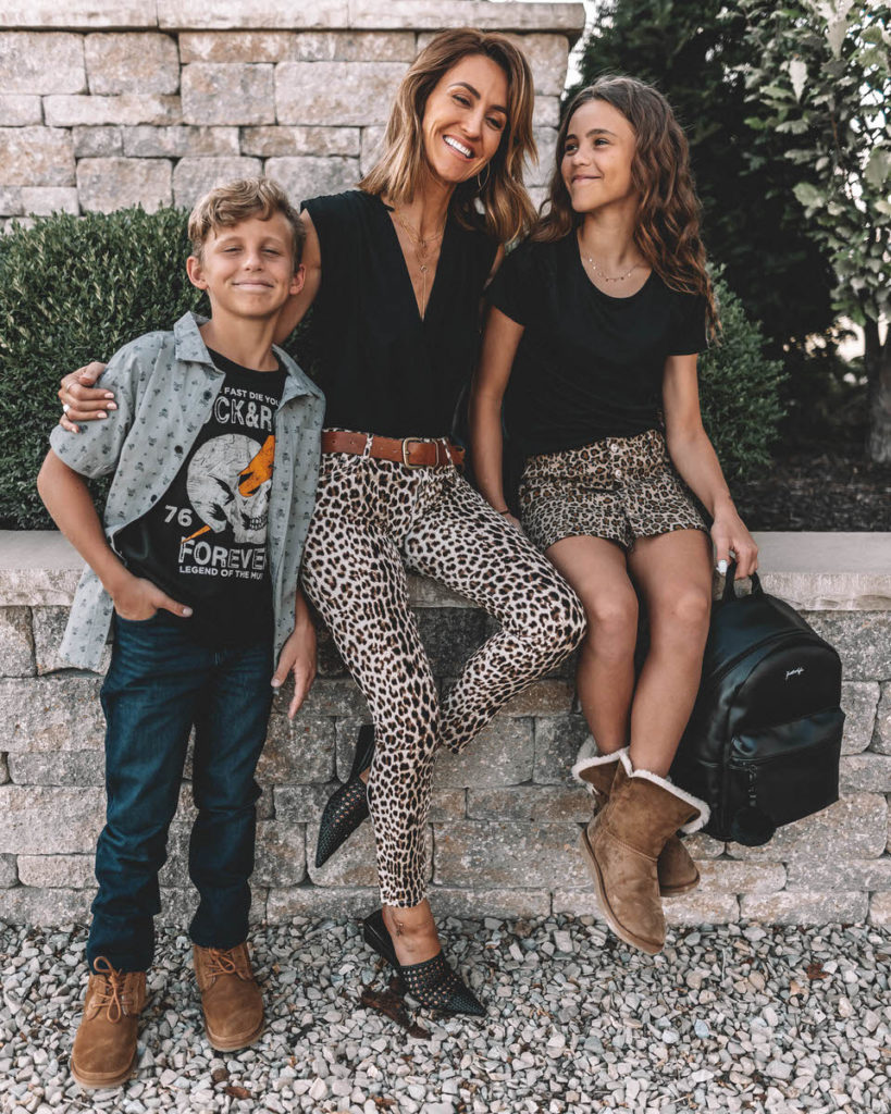 Karina Style Diaries Kids Back to School outfit ideas leoard print skirt black top Kendall and Kylie black back pack rocker tee boys outfit