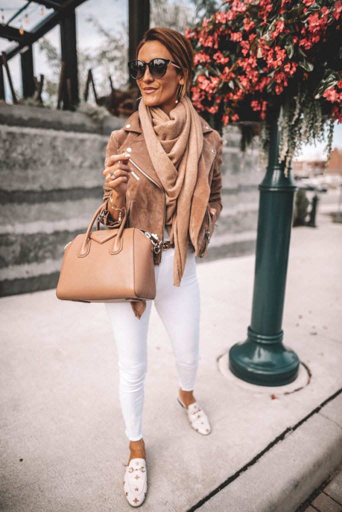 Karina Style Diaries wearing white jeans chic outfit suede moto jacket cashmere scarf gucci princetown bumblebee loafer givenchy antigona gucci belt