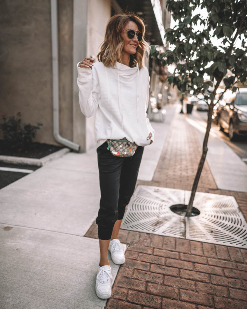 Karina Style Diaries wearing white cowl neck sport pullover black joggers white snekakers casual black & white outfit