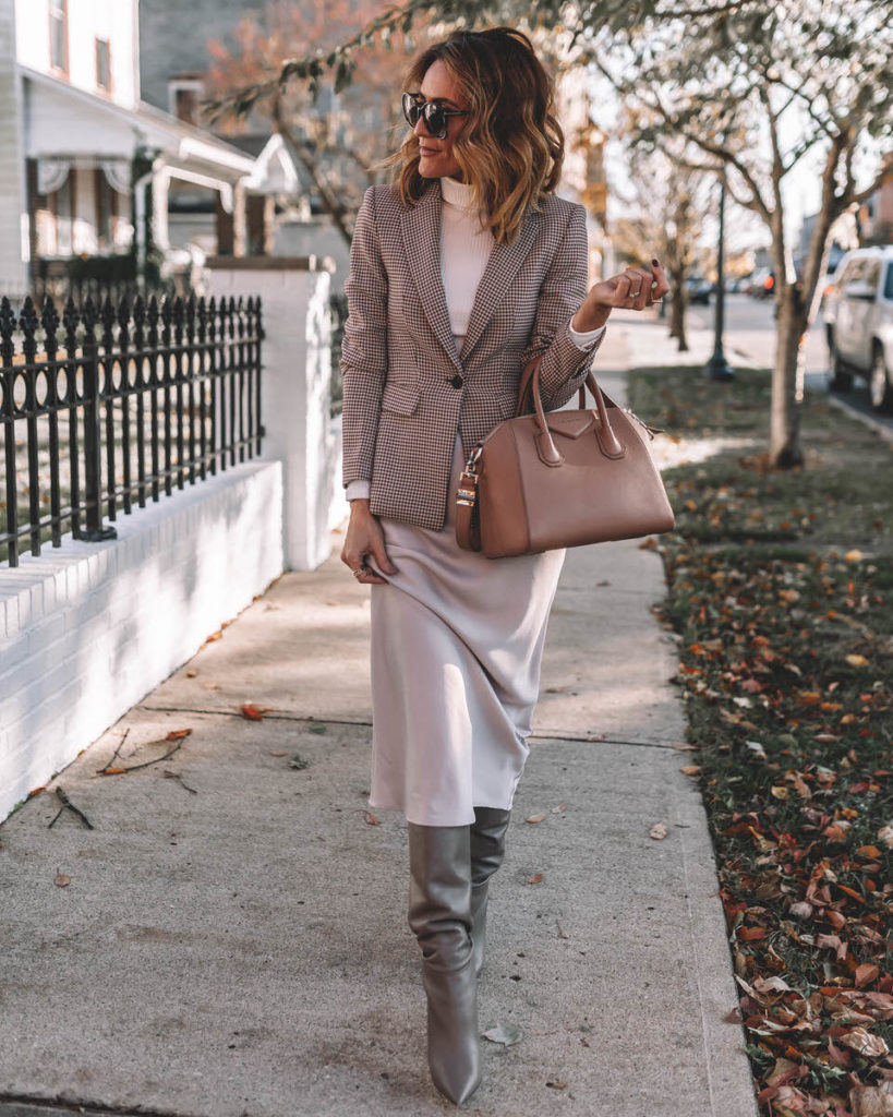 Karina Style Diaries wearing silk skirt knee high boots plaid blazer turtleneck top Givenchy Antigona Small