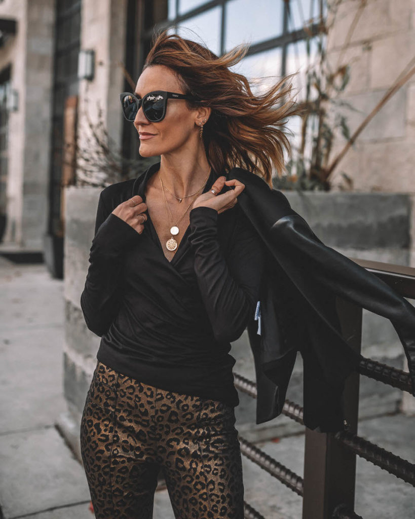 Karina Style Diaries wearing black long sleeve top gold leopard print pants work holiday outfit