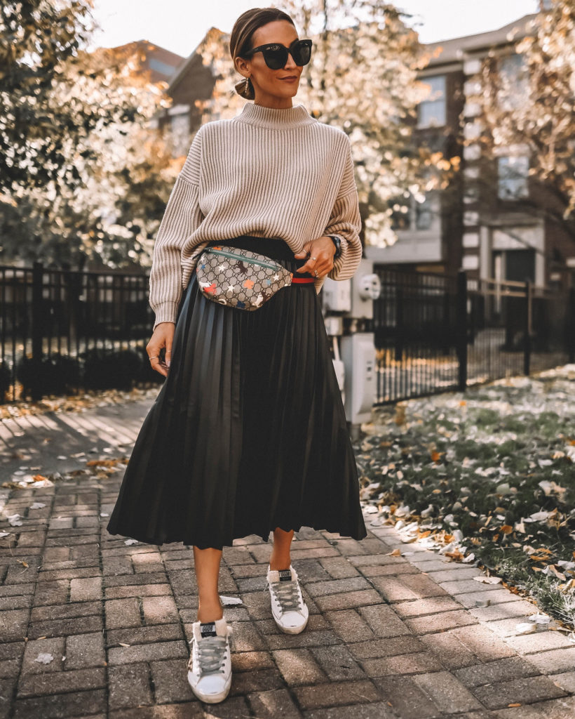 Karina Style Diaries pleated skirt oversized sweater Gucci belt bag Golden Goose sneakers