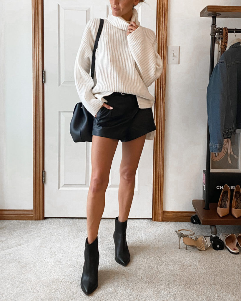 white oversized sweater ankle booties black leather shorts outfit