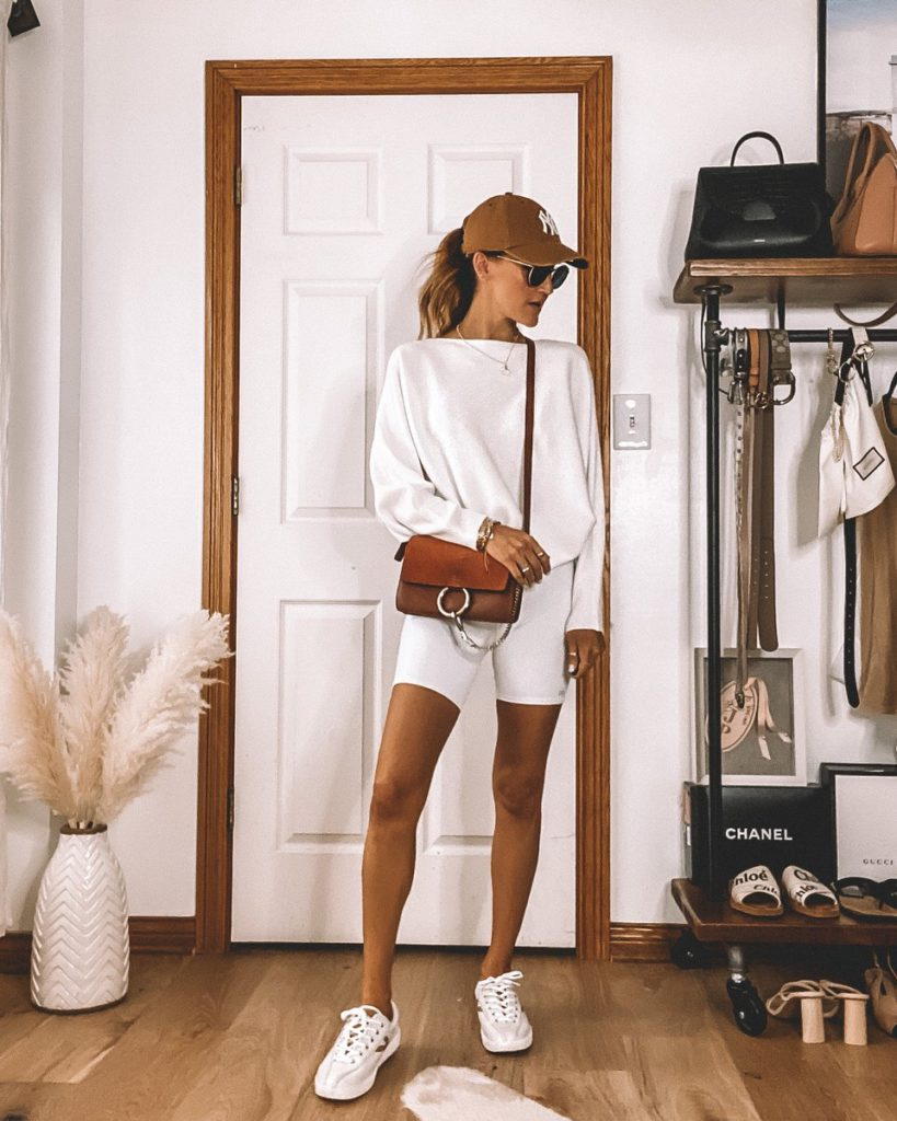 Karina Style Diaries wearing white biker shorts dolman sleeve sweater camel hat all white summer outfit