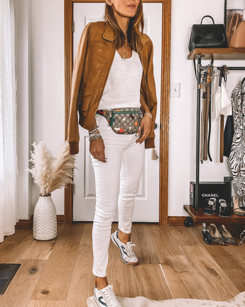 High waisted skinny cropped white jeans Gucci belt bag camel bomber jacket casual street style