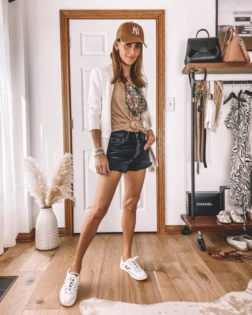Karina Style Diaries wearing agolde black cut offs tan oversized tee white blazer summer sporty casual outfit
