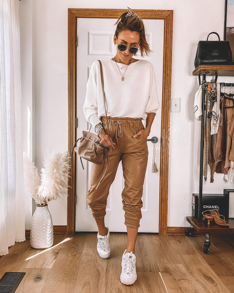 Karina Style Diaries styling faux leather joggers white sweater white sneakers croos body Protea bag Mansur Gavriel Sporty Style
