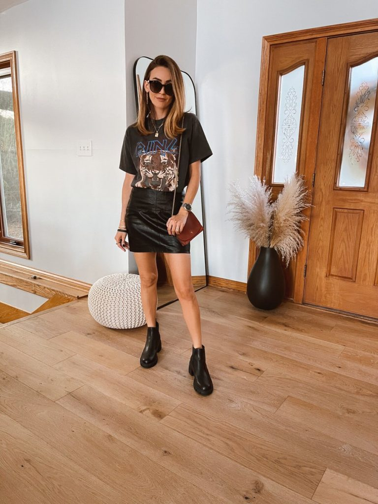 Karina Style Diaries wearing leather mini skirt graphic tee steve madden booties neutral style