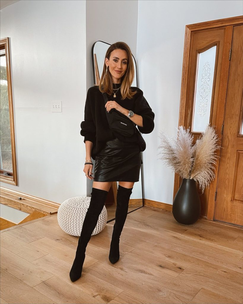 Karina Style Diaries wearing leather mini skirt free people tunic over the knee boots balenciaga bag neutral style