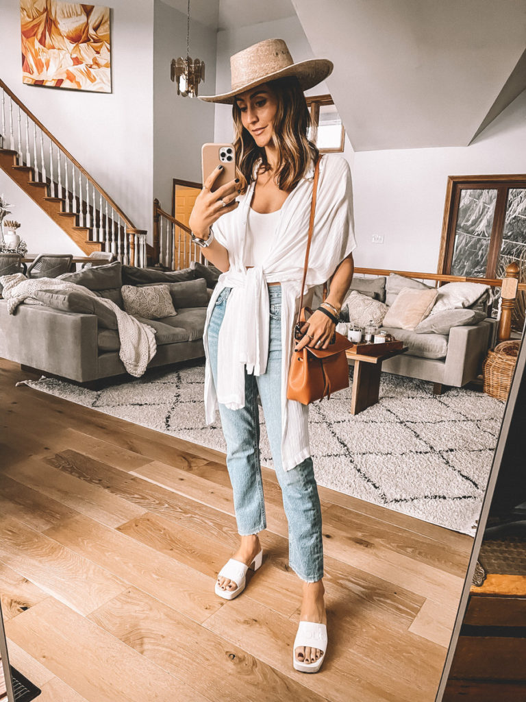 Karina Style Diaries wearing Agolde Riley Jeans, L'space anita coverup, Waybe hat, Gucci jellie white sandals