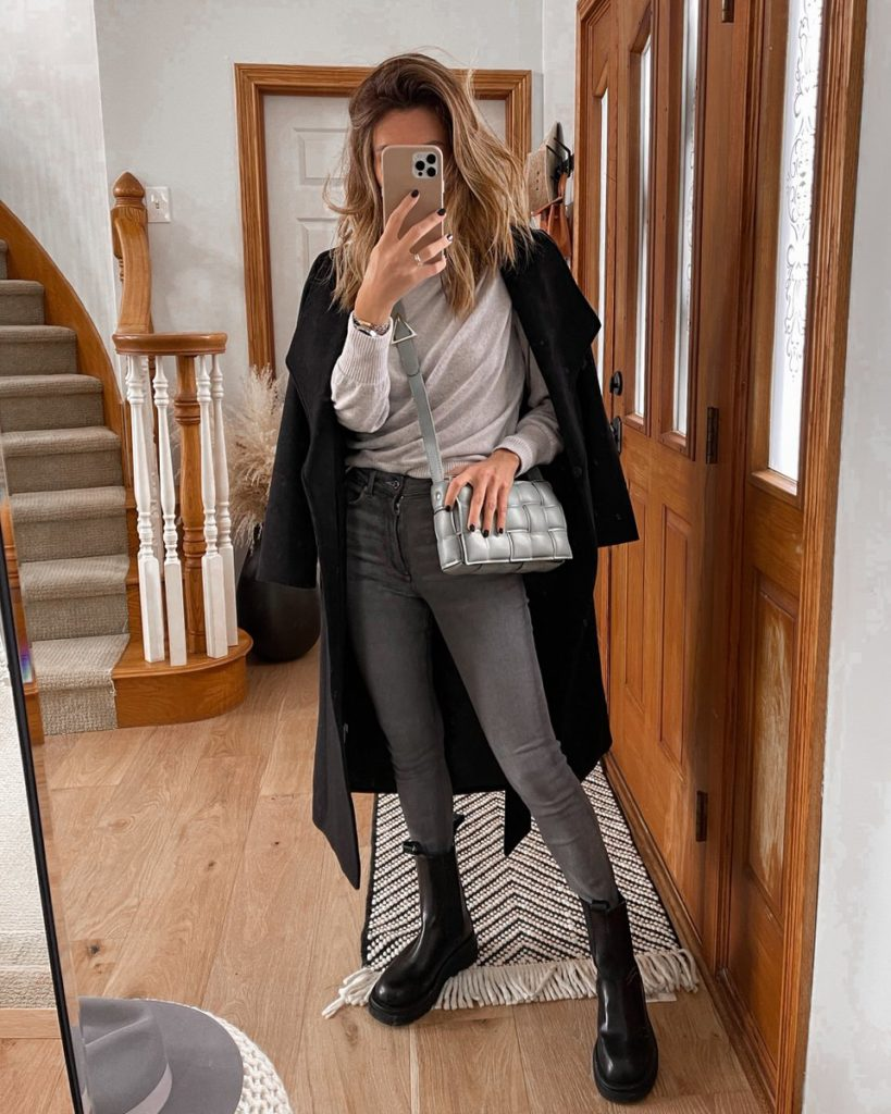 Black oversized coat, gray sweater, grey jeans, lug boot outfit