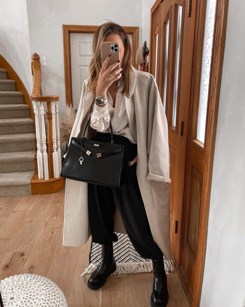 Woolen coat, silk blouse, high waisted ankle pants, lug boot outfit