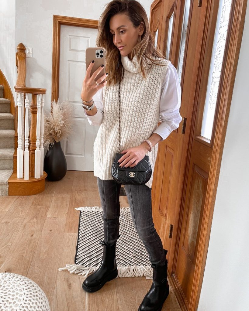 Sleeveless turtleneck, gray jeans, chanel bag, lug boots outfit